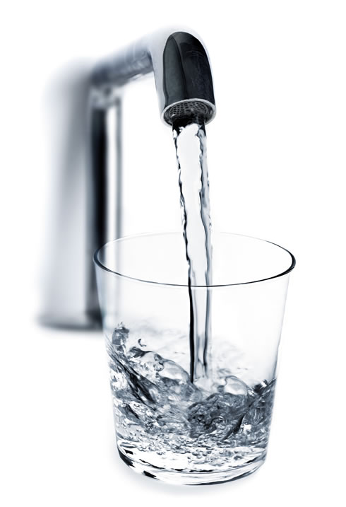 Water faucet filling water glass